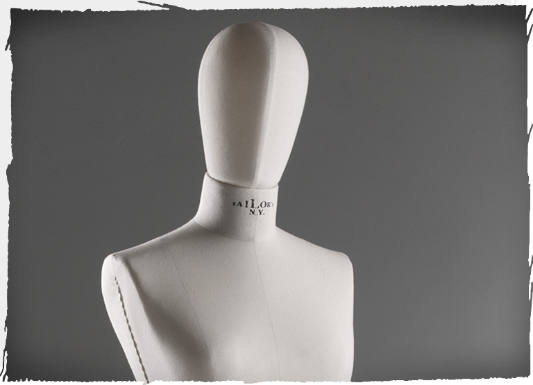 White bust with a fabric-covered mannequin head